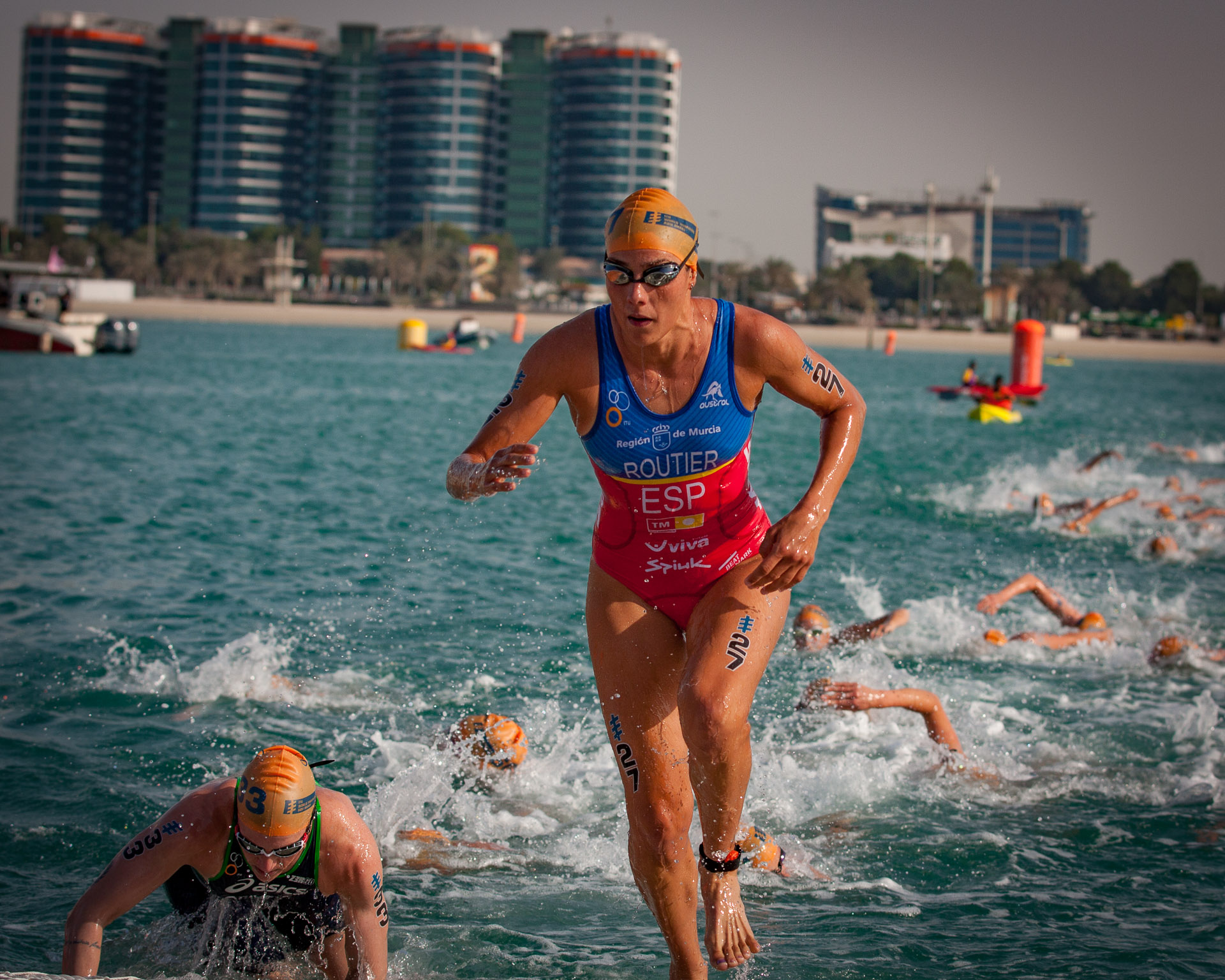 ABU DHABI, UAE (MARCH 5, 2016) -- Carolina Routier of Spain finishes the first lap of the swim at the season opening race for the 2016 ITU World Triathlon Series.